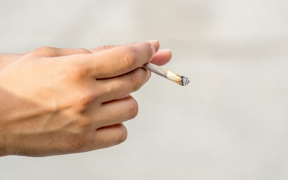 Hand with Rolled Cigarette or Joint