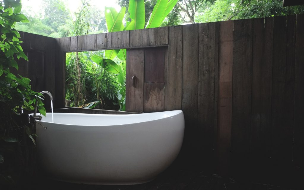 white bathtub in outdoor bath