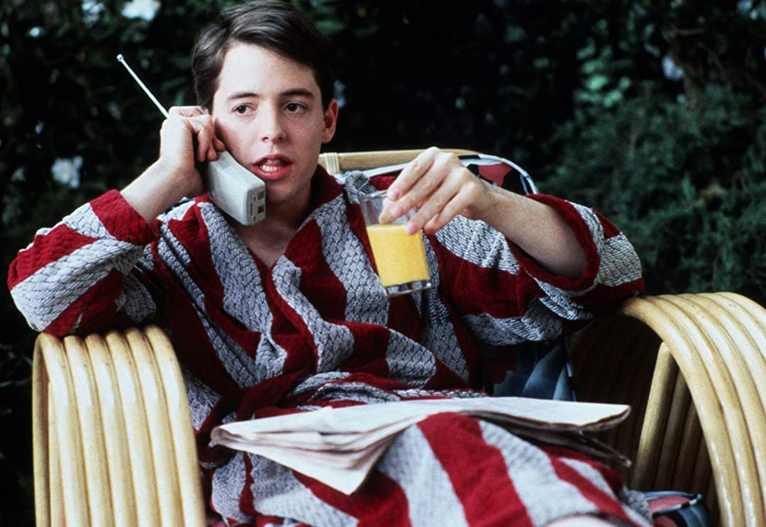 Image of Ferris Bueller on the phone in a robe