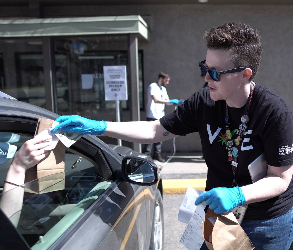 A Terrapin Care Station employee in Colorado conducts curbside pickup March 26, 2020. (Courtesy Terrapin Care Station)